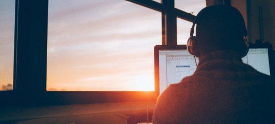 man listening to webinar