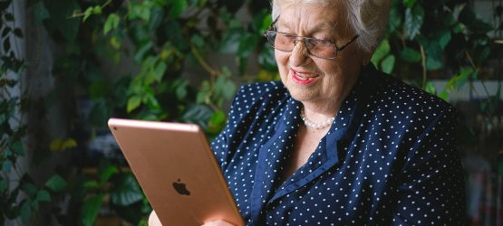Senior woman using ipad